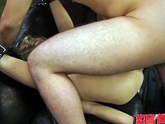 Alli has her legs pulled back by restraints and cables, mouth gagged, and totally at the mercy of her executor. The gloved dominant fingers her deeply and uses a big vibrator on her clit, making her very wet. After he feels she's had enough, he sets her legs free and un-gags her mouth to suck him.
