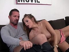 Long haired busty bombshell Candy Alexa takes off her bra and plays with her huge tits in front of a lucky man. Then topless beauty goddess in pink panties takes care of of his beefy cock.