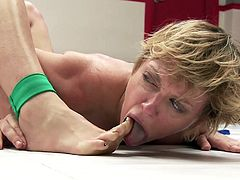 Ginger sex kitten Cheyenne, dispatched Darling fairly easily in their Ultimate Surrender match, so she's enjoying her victory. She fucks her very roughly from behind, has her suck her toes, sits on her face, and pumps her asshole full of latex cock. Darling should have practiced her wrestling better.