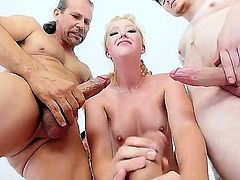 Cute woman with natural boobs is smeared with cum of three different men. That is how many guys she is having sex with in this video. She is a real slut. Group sex.