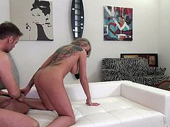 Tattooed blonde slut Kayla Green with big natural tits and sexy ass gives hot blowjob to Rocco Siffredi. Naked babe with heavy makeup enjoys his meaty sausage in her mouth.