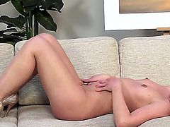 Kala Ferard is a delicious redhead with a shaved pussy. She is massaging herself on the sofa. Her nipples are getting perked up with all that sexy play.