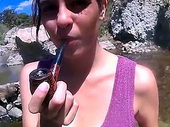 Beautiful girl smoking her pipe
