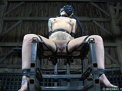 Delirious might be feeling just like her name, when this is all done with. With hands bound, mouth gagged, she's now lashed to the chair and has a gas mask on. Her executor is hitting her with something, although it's not clear what it is. She accepts her fate.