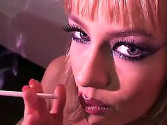 Cute blonde is smoking for all you that have a smoking fetish. The solo girl is really pretty and her eyes are staring seductively as she is handling a cigarette.