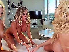 Courtney Taylor, Samantha Saint and Summer Brielle are feeling a bit kinky so they get naked and have a threesome in the living room. No lesbian threesome would be complete without a large dildo.