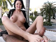 Busty slut massages with her feet