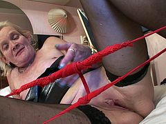 Dutch granny Loreen fucks herself with a rubber dick