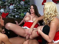 Brooklyn, Nicole, and Summer are with Xander. The are feeling the Xmas spirit and they are having group sex with each other. The chicks all have sizable tits and asses.