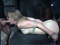 Mona Wales is bound, barely unable to move and is at the will of her bi-racial masters. Watch her take a fat, black cock up her nicely rounded ass, while gagging and being made to suck a huge, white fuck pole.