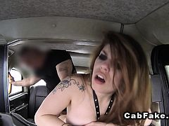 Tattooed hottie anal banged in fake taxi