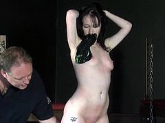 of amateur bdsm slave girl by two sadistic dominants mercilessly cracking the whip over her boobs