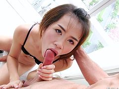Johnny knows just how to please this stunning and beautiful Asian ladyboy. The Thai tranny is rock hard soon after he puts his lips on her veiny dick. The way he uses his tongue, drives the cutie wild. She wants to blow him, too.