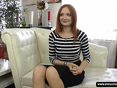 A redheaded girl named Eva Berger has an interview prior to her porn scene debut. After showing off her small tits and her round ass, a black guy joins to offer her his big cock. She sucks his dick and then bends over so he can fuck her pussy. He even fucks her tight ass with his long dick.