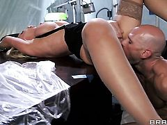 Dangerously horny sweetie Nikki Benz with giant breasts shows off her hot body as she gets her mouth banged by Johnny Sins