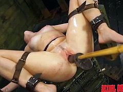 Tied up and bound, naughty girl Charli, is about to have her wet cunt stretched beyond belief. The long pole has a big black dildo attached to the end, and master rams her tight pussyhole like mad. She takes it deep.