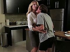 A tall blonde with nice tits is giving a blow job and is kissing in the kitchen. Check her out in her most intimate moments with a man that she loves.