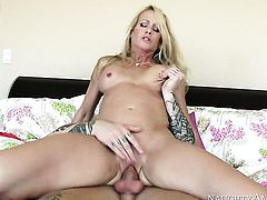 Blonde exotic gal Simone Sonay with firm ass and trimmed pussy has fire in her eyes as she milks cum loaded meat pole of her guy