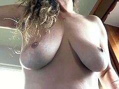 Housewife cleans in the nude and flaunts her tits