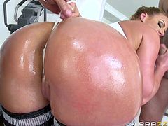 Phoenix has a big booty and some really big boobs. With all that, one dick is really not enough for her. That's why she gets two for herself. She gets her ass and tits all oiled up and stars sucking them.