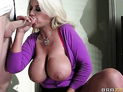 Huge tits blonde is getting licked