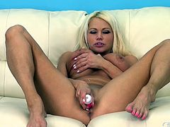 Blonde babe with bodacious tits goes to work on her pussy with a vibrator