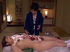 Sensual massage for a lovely chick with a curvaceous oiled body