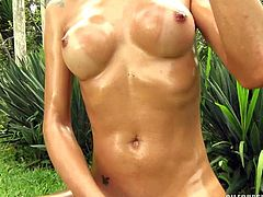 Dany is a bad girl with a wild side. The elegant tranny has no problem with stripping nude outside and playing with her hard cock. The hot slut strokes off her dick, until she burst her cum all over the grass.