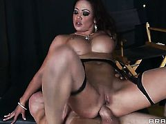 Brunette with huge breasts keeps her legs apart to be boned over and over again in steamy interracial action