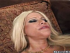 Blonde hooker Gina Lynn with gigantic boobs and clean snatch cant live a day without playing with her cunt