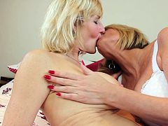 Old lesbian women Amy and Molly, in hot sexy lingerie, with their shaved pussies and nylon stockings enjoys each other in bed, in a hot scene, involving kissing, breast fondling, boob sucking and playing with each other's bodies.