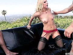 Blonde seductress Ashley Fires plays with guys hard cock
