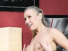 Blonde Silvia Saint gives a closeup view of her pussy hole as she masturbates with dildo