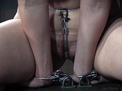 Kel decided to get dominated, but she apparently hasn't been good so far. She has a chain around her neck which will choke her if her head goes down. She also has a chain on either side of her pussy as well, attached to something on her belly button.