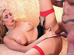 Blonde Paige Turnah with massive breasts makes studs cock harder before getting her ass pumped
