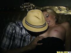 Blonde has fire in her eyes while blowing mans stiff cock