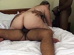 Triple teaming a slutty porker in a hotel bed