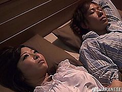 Wake up and play with the large titty Japanese hottie in underware