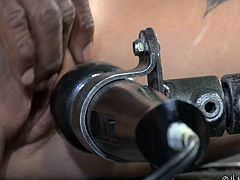Kleio Valentien and Endza Adair are kept in the dark dungeon. Tied sex slaves are naked and placed in a special bondage devices. Endza's pussy is constantly stimulating with the help of vibrator, while busty tattooed Kleio, will be drilled by her severe ebony master, literally. Brutal domination! Enjoy!