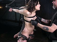 Juliette's executor has her suspended in midair, arms bound and held straight back behind her. He toys with her a bit, taking a few opportunities to roughly pinch her nipples, making her cry out in pain.