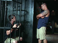 Johnny Rapid committed a robbery and ended up in the police station, now he is sitting behind the bars. Suddenly, the guard makes him a tempting offer. He promises to help him to escape from prison, if he will suck his dick and will lick his ass. Watch Johnny swallowing cock and balls, behind the bars, with passion. Enjoy!