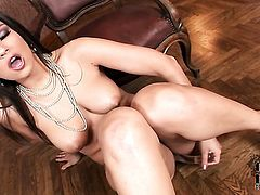 Eve Angel touches her breasts in a playful manner