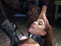 slutty roxanne in hard metal bondage