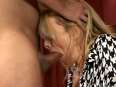 Suave blonde with large boobs spreads her legs for the sausage