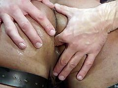 bound slave gets hot wax on his ass