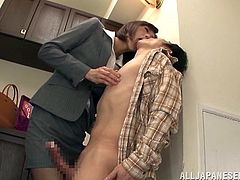 Clothed Japanese office babe teases his cock relentlessly