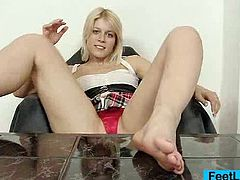 Very handsome blond goddess takes sucks off her feet, then oils her foot and performs a fake cock footjob
