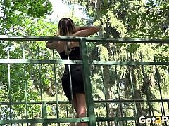 Babe pissing off a bridge in public