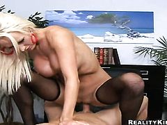 Blonde Reno with gigantic boobs and clean twat is good on her way to make horny guy ejaculate on oral action