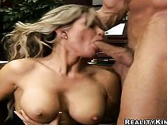 Blonde Reno with gigantic melons and hairless pussy gets the mouth fuck of her dreams with hard dicked guy